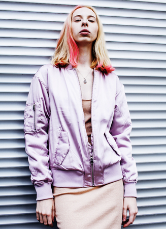 pinky: Young pretty fashion dressed blond teenage girl posing friendly