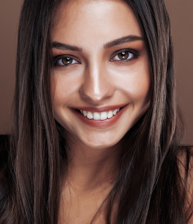 cute happy young indian real woman in studio close up smiling, fashion mulatto
