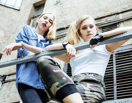 two cool blond real girls friends making selfie on roof top, lif
