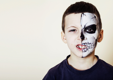 little cute boy with facepaint like skeleton to celebrate hallow Stock Photo
