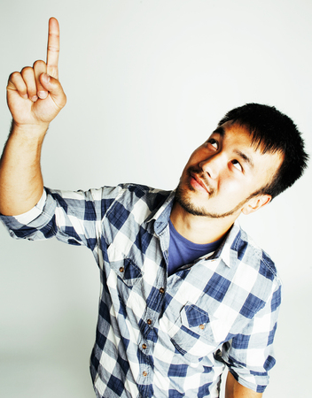 po: young cute asian man on white background gesturing emotional, po Stock Photo