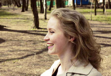 young pretty blonde girl enjoing spring nature in park, lifestyl