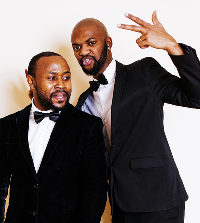 dinky: two afro-american businessmen in black suits emotional posing, g