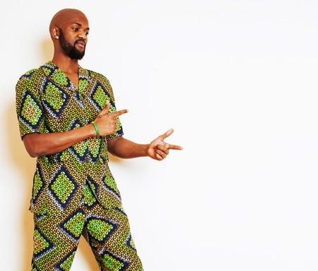 country nigeria: portrait of young handsome african man wearing bright green nati Stock Photo