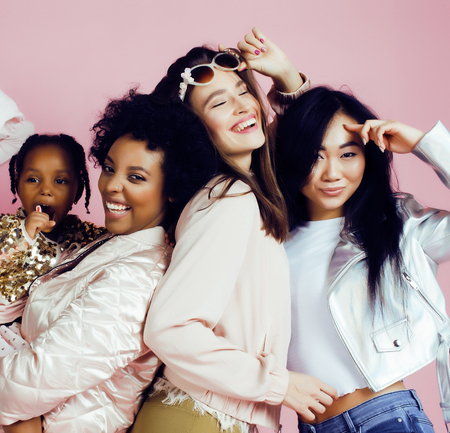 children party: Lifestyle and people concept: young pretty diversity nations woman with different age children celebrating on birth day party together happy smiling, making selfie. African-american, asian and caucasian