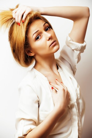 young blond woman on white backgroung gesture thumbs up, isolate