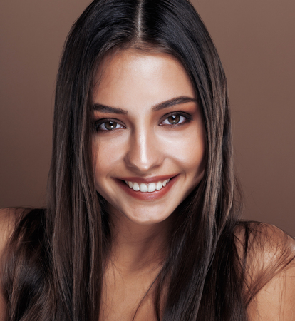 cute happy young indian real woman in studio close up smiling, fashion mulatto, lifestyle people concept Stock Photo
