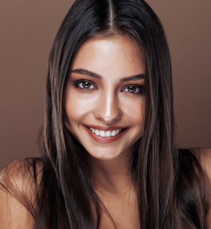 cute happy young indian woman in studio close up smiling, fashion mulatto, lifestyle people concept Stock Photo