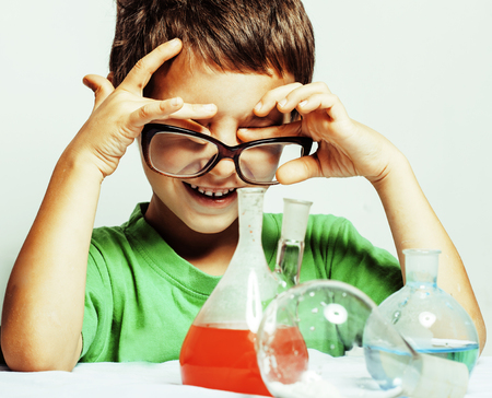 little cute boy with medicine glass isolated Stock Photo