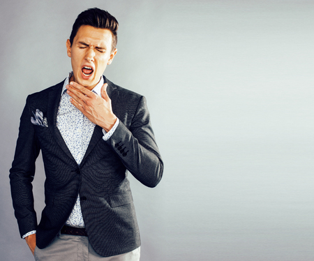 young pretty businessman posing emotional on white background, l Stock fotó
