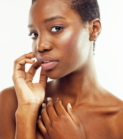 young pretty african american woman naked taking care of her skin isolated on white background, healthcare people concept 写真素材