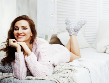 young pretty brunette woman in her bedroom sitting at window, happy smiling lifestyle people concept close up Banco de Imagens