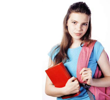 young cute teenage girl posing cheerful against white background with books and backpack isolated, lifestyle people concept close up