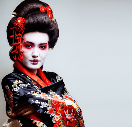 young pretty geisha in kimono with sakura and red decoration des Stok Fotoğraf