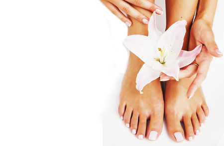 manicure pedicure with flower lily close up isolated on white Stockfoto