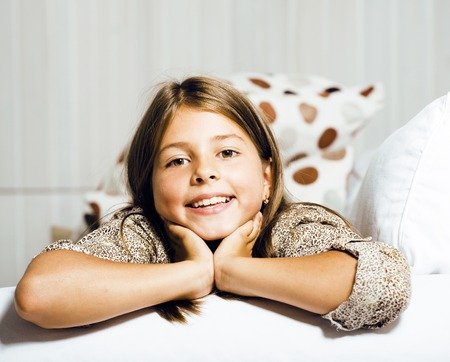 little cute real girl at home interior smiling Stock Photo