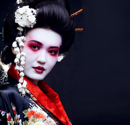 young pretty geisha in kimono with sakura and decoration Stok Fotoğraf - 90757521