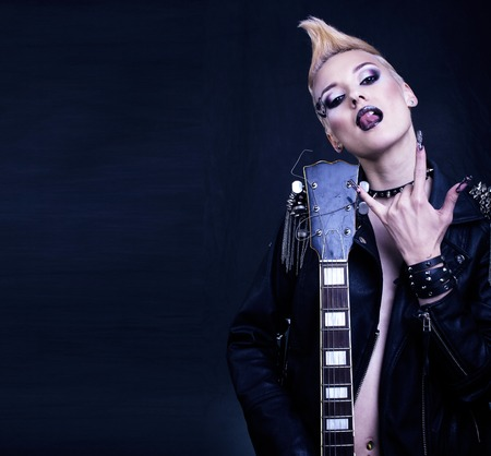 Fashion Rocker Style Model Girl Portrait. Hairstyle.Punk Woman Makeup, Hairdo and black Nails. Smoky Eyes Stock Photo