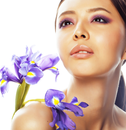 young pretty asian woman with flower purple flower-de-luce close up isolated spa, womans day concept