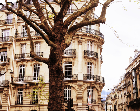 houses on french streets of Paris. citylife concept, black balco Stock Photo