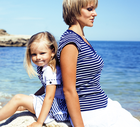 mother with daughter at sea cost together, happy real family lif Stok Fotoğraf