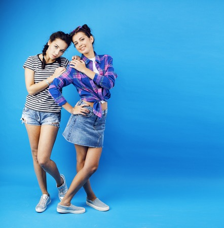 best friends teenage school girls together having fun, posing em