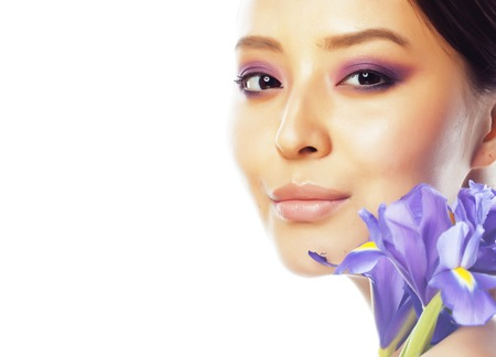 young pretty asian woman with flower purple orchid close up isol Banque d'images - 95591369