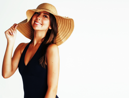 young pretty brunette woman wearing summer hat and swimsuit isol