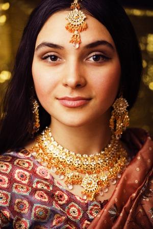 beauty sweet real indian girl in sari smiling on black backgroun