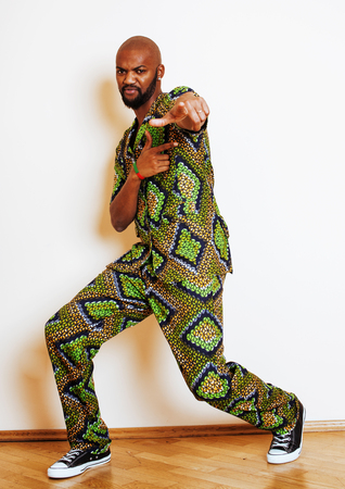 portrait of young handsome african man wearing bright green nati 스톡 콘텐츠