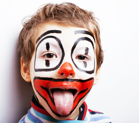 little cute boy with facepaint like clown, pantomimic expression Stock Photo