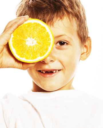 little cute boy with orange fruit double isolated on white smili