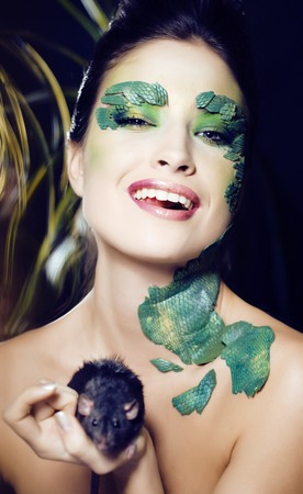 woman with creative make up like snake and rat in her hands, hal Stock fotó