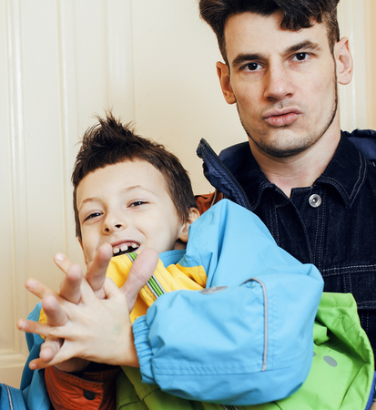 young handsome father with his son fooling around at home, lifes