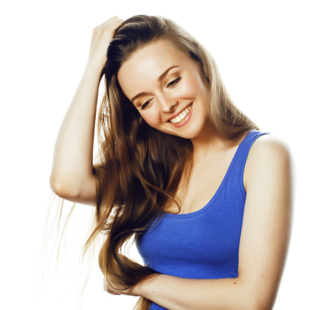 young blond woman on white backgroung smiling gesture thumbs up,