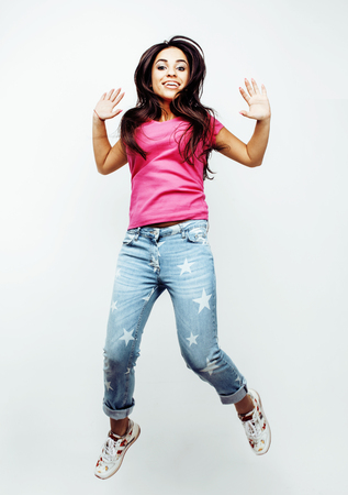 young happy smiling latin american teenage girl emotional posing on white background, lifestyle people concept Stock Photo