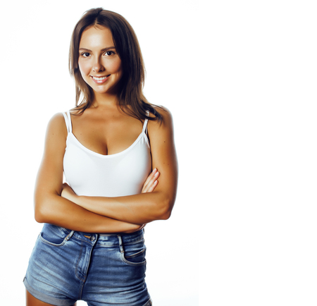 young pretty brunette woman in jeans shorts isolated on white sm 스톡 콘텐츠