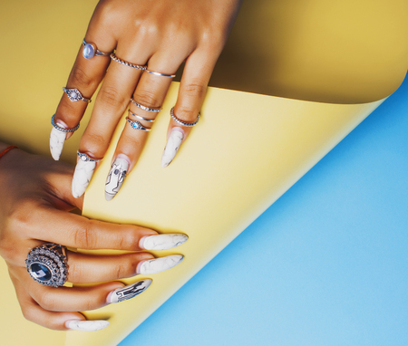 woman hands holding colorful paper copyspace wearing a lot of or