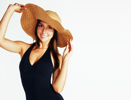 young pretty brunette woman wearing summer hat and swimsuit isol Banque d'images - 99958051