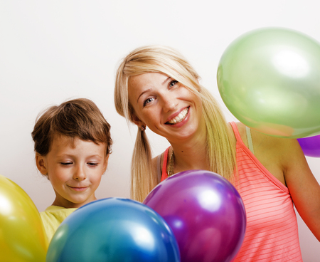 pretty real family with color balloons on white background, blon Banco de Imagens