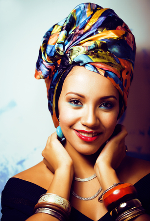 beauty bright african woman with creative make up, shawl on head Foto de archivo