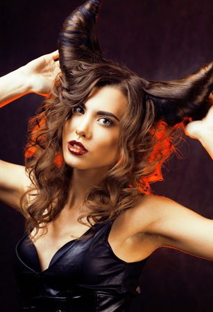 bright mysterious woman with horn hair, halloween celebration Banco de Imagens