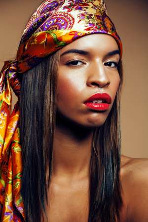beauty bright real african woman with creative make up, shawl on
