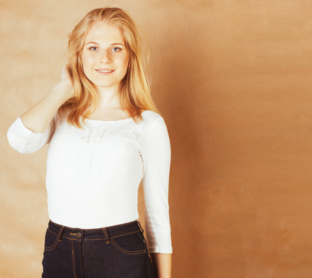 young pretty happy smiling blonde woman closeup warm colors, lif