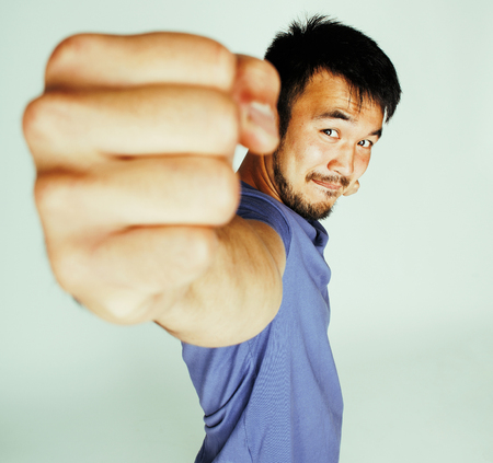 young cute asian man on white background gesturing emotional, po Stok Fotoğraf