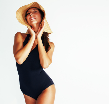 young pretty brunette woman wearing summer hat and swimsuit isol Banque d'images - 108744843