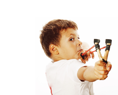 little cute angry real boy with slingshot isolated Stock Photo - 108986013