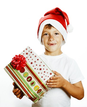young pretty boy in santa red hat isolated on white background