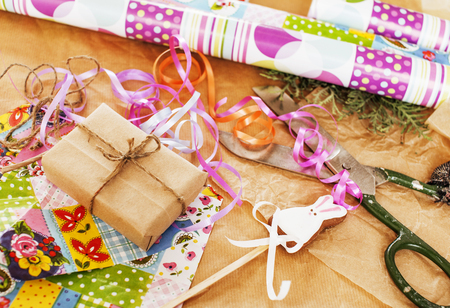 lot of stuff for handmade gifts, scissors, ribbon, paper