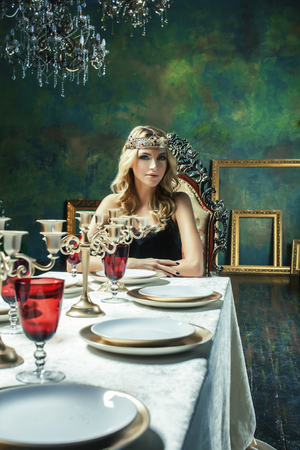 young blond woman wearing crown in fairy luxury interior